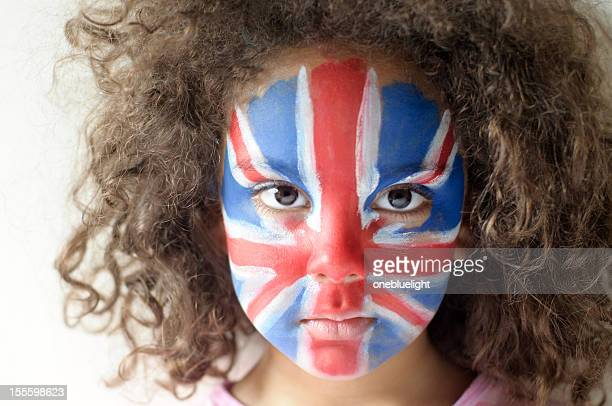 Girl (5-6) With Union Jack Face Painted Looking Serious