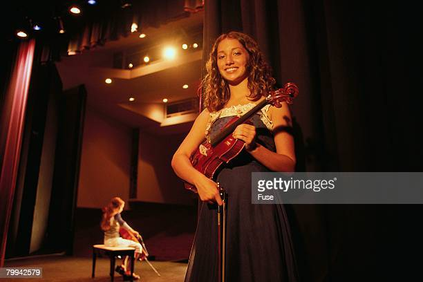 girl with violin waiting backstage - performing arts center stock pictures, royalty-free photos & images