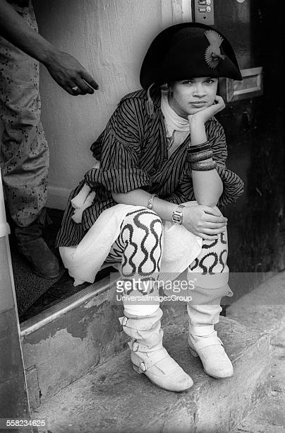 Girl with Vivienne Westwood's Pirate look sits outside 'World's End' shop on Kings Road Chelsea London 1980