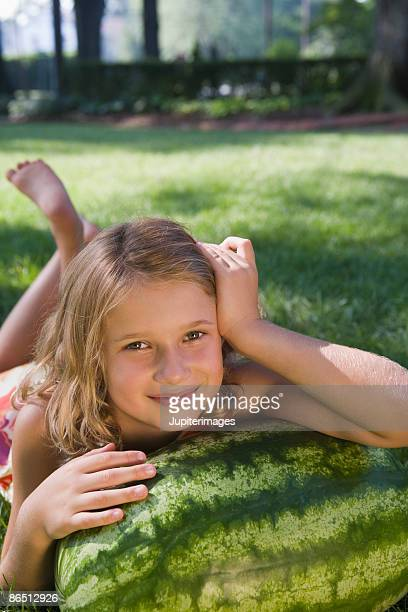 girl with watermelon - barefoot feet up lying down girl stock photos and pictures