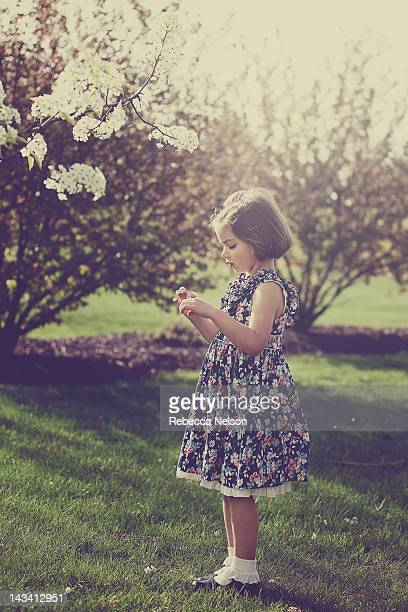 Girl with white blossoms