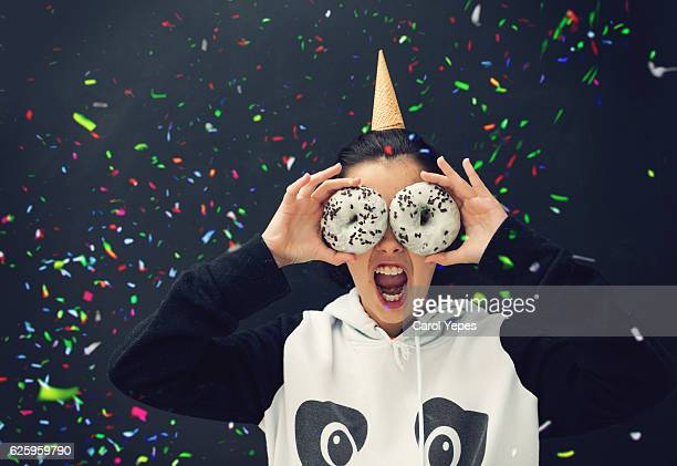 girl with white  donuts in front of her eyes and ice cone on head - fat people eating donuts stock pictures, royalty-free photos & images