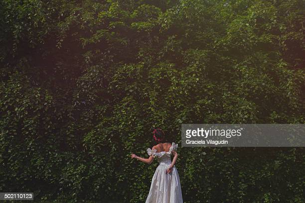 Girl with white dress in a park