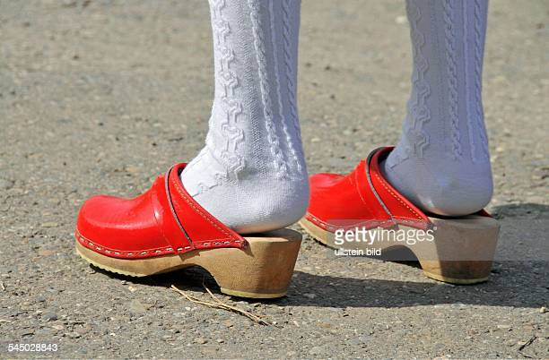 girl with white stockings and red clogs