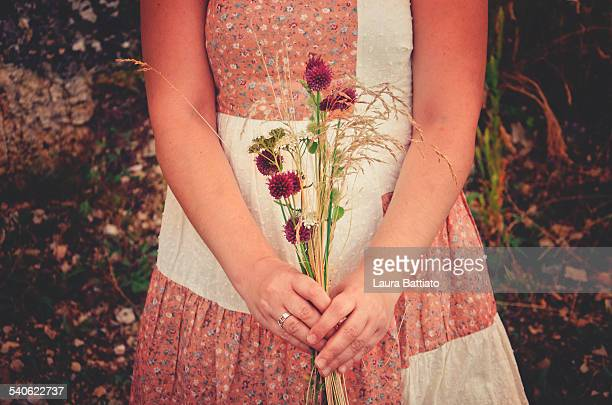 Girl with wildflowers