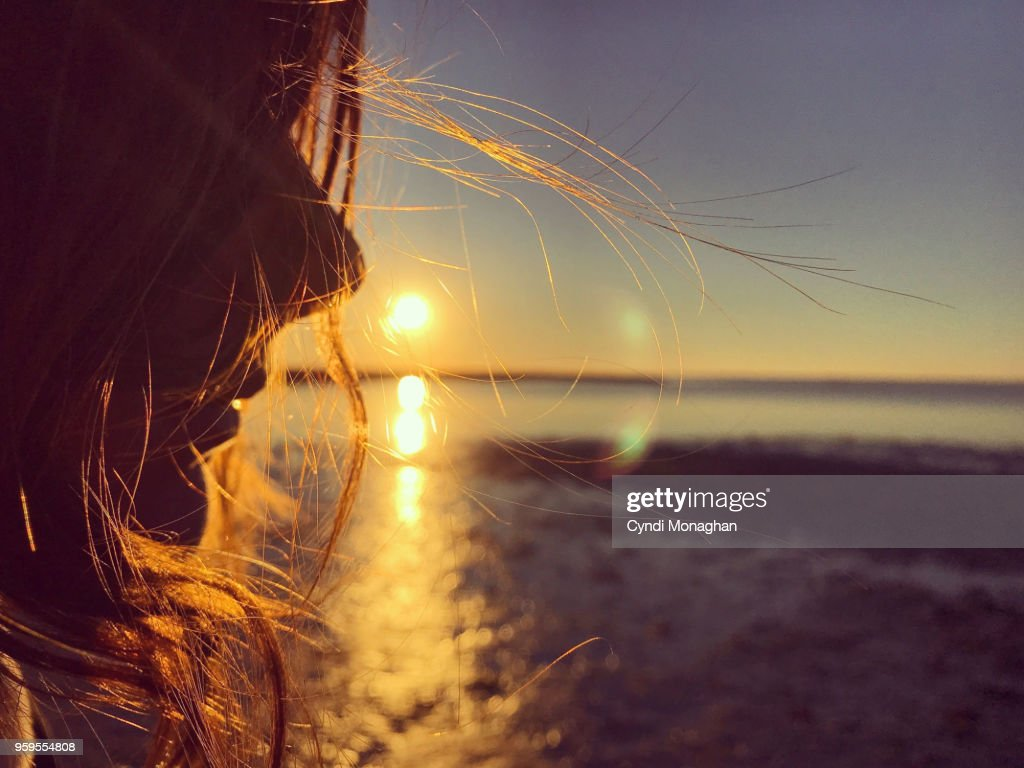 Girl with Windswept Hair at Sunset : Stock-Foto