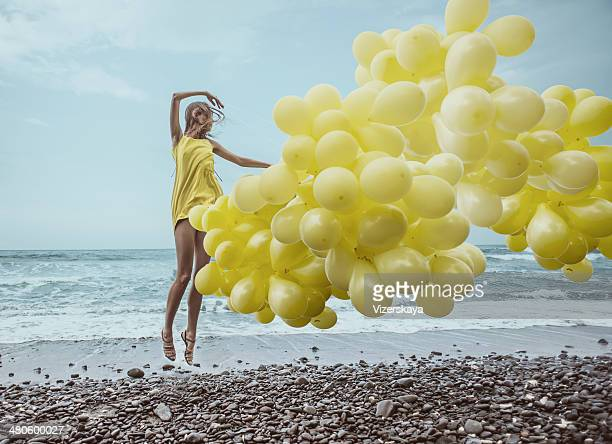 girl with yellow balloons - yellow dress stock pictures, royalty-free photos & images