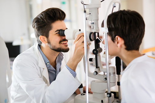 Girl woman in ophthalmology clinic for diopter detection 881592556