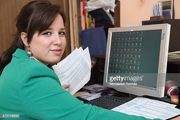'Girl working at pc Milan Italy May 2014 '