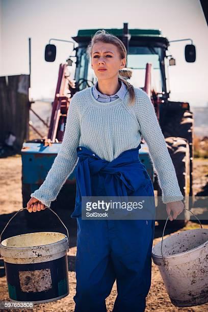 Girl Working Hard on the Farm