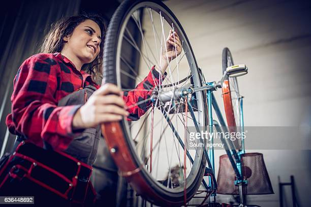 Girl working on her bicycle