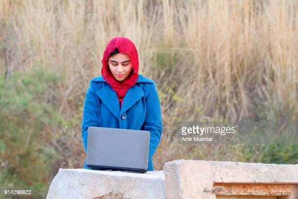 A Girl Working Outdoor On Digital Laptop