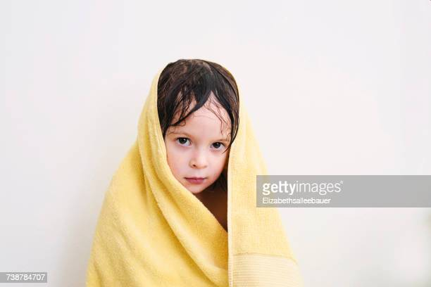 Girl wrapped in a towel after her bath