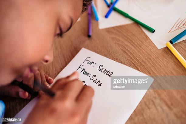 girl writes the letter to santa claus - happy new month stock pictures, royalty-free photos & images