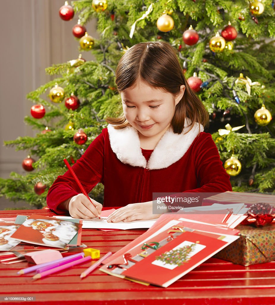 girl writing christmas cards stock photo getty images