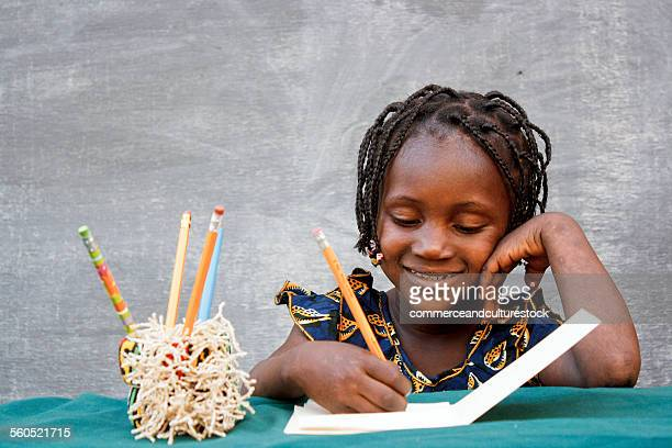 Girl writing in a copybook