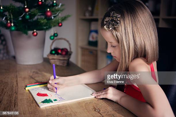 Girl  writing  letter at Christmas
