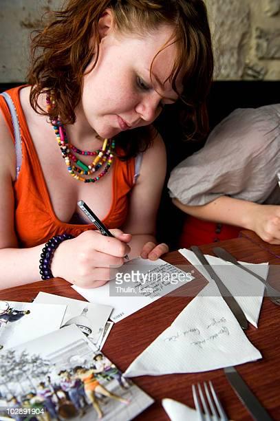 Girl writing postcard