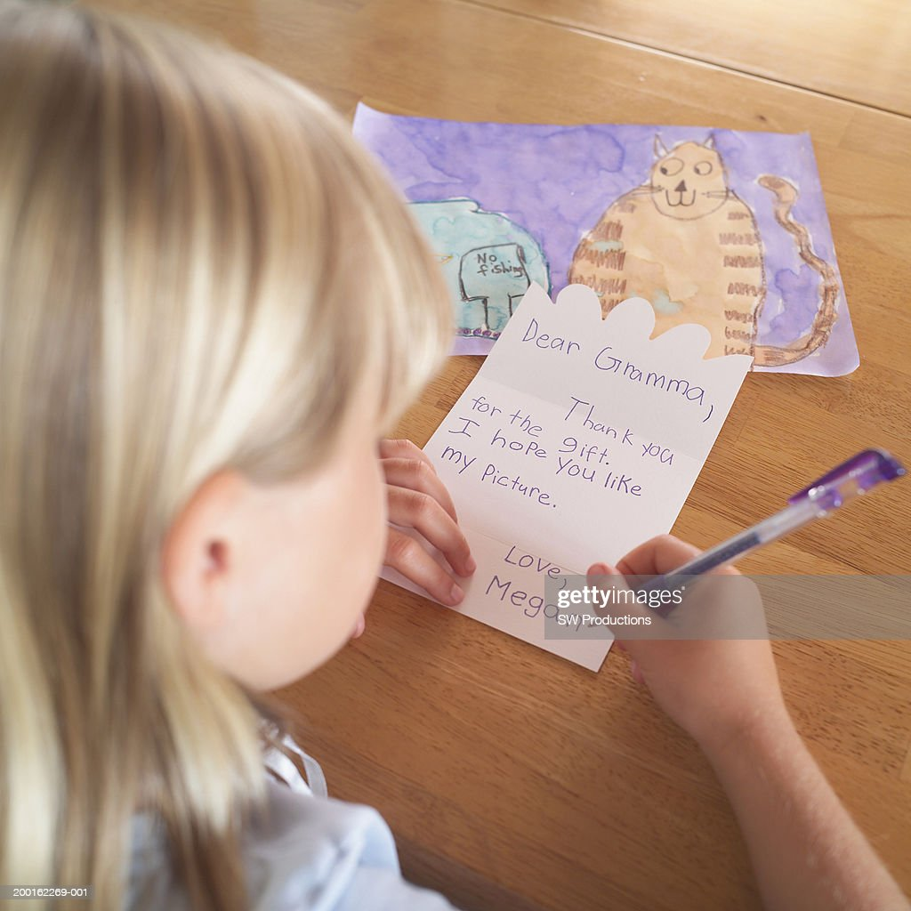 Girl Writing Thank You Card To Grandmother Rear View Stock Photo