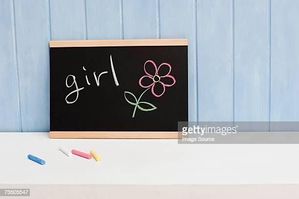 Girl written on a blackboard