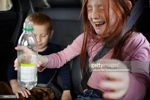 Girl yelling in backseat of car