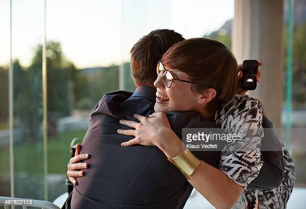 Girlfriend hugging boyfriend after getting ring