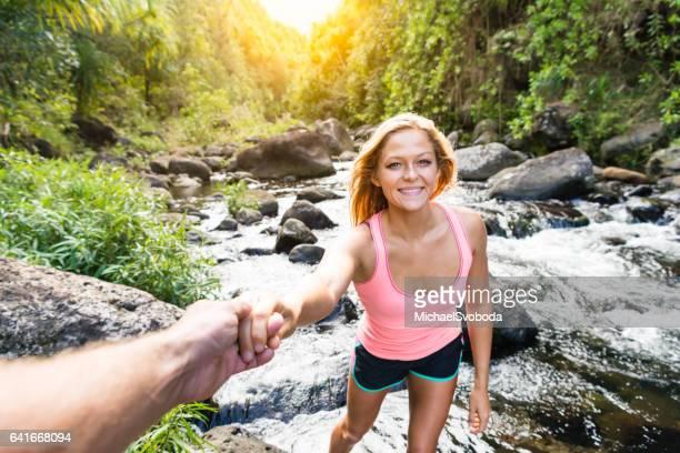 Girlfriend Leading Her Boyfriend Through The Jungle