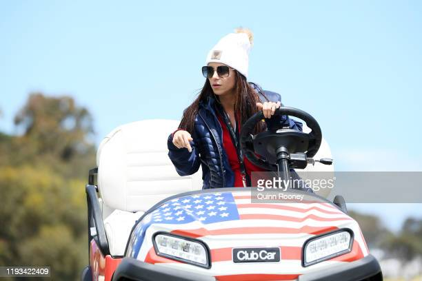 Girlfriend of Playing Captain Tiger Woods of the United States team, Erica Herman looks on from a cart during Thursday four-ball matches on day one...