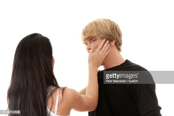 girlfriend slapping boyfriend against white background - slapping stock pictures, royalty-free photos & images