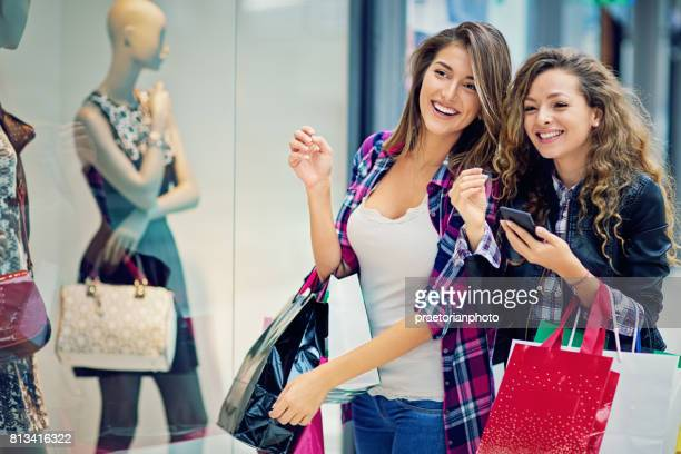 girlfriends are looking store window in the mall - bulgarian girl stock photos and pictures