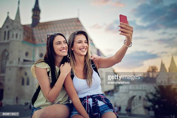 Girlfriends are taking selfie/making video call