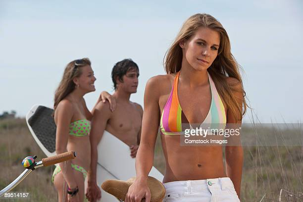 girlfriends at the beach surfing