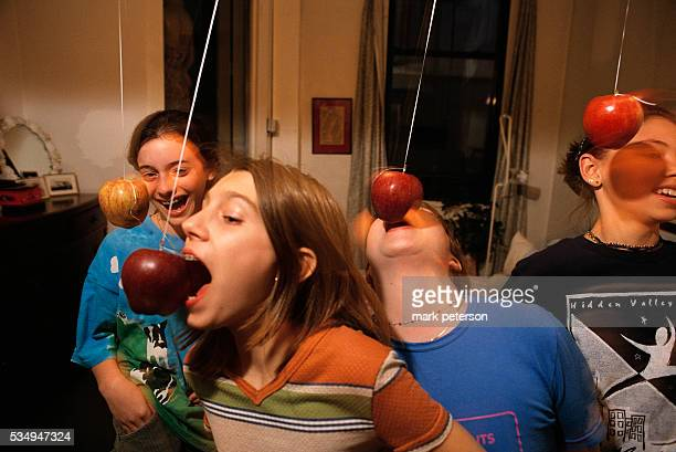 Girlfriends Bobbing for Apples During Slumber Party