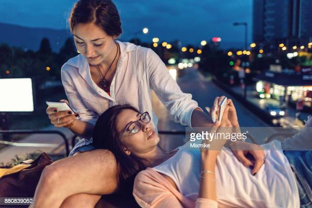 Girlfriends browsing on their mobile phones