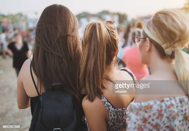 girlfriends captured from behind - off shoulder stock pictures, royalty-free photos & images