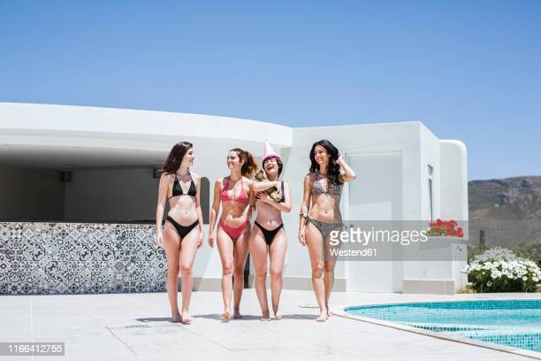 girlfriends celebrating birthday at the pool - pink hat stock pictures, royalty-free photos & images