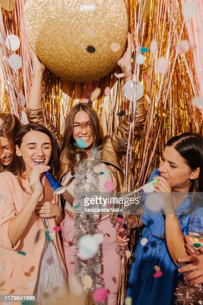 girlfriends celebrating new year's eve - december stock pictures, royalty-free photos & images