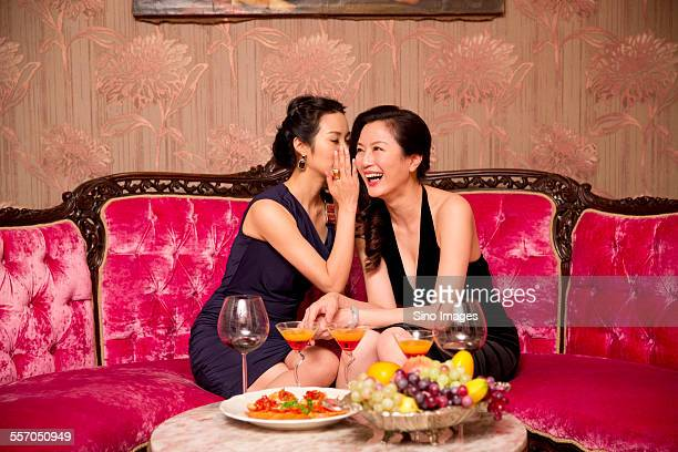 Girlfriends Chatting in a Club