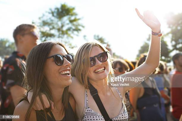 2 girlfriends cheering at concert outside - festival or friendship not school not business stock photos and pictures