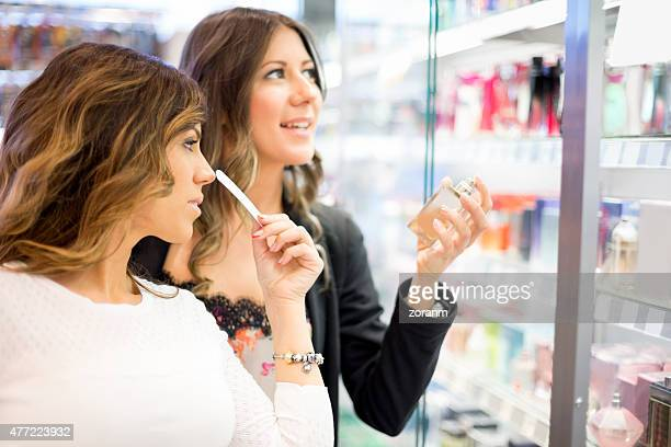 Girlfriends choosing perfume