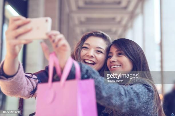 Girlfriends doing selfie in the city.