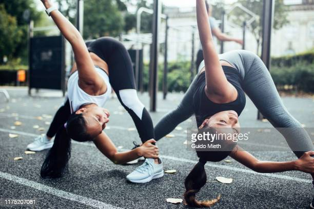 girlfriends doing stretching before fitness training. - sports stock-fotos und bilder
