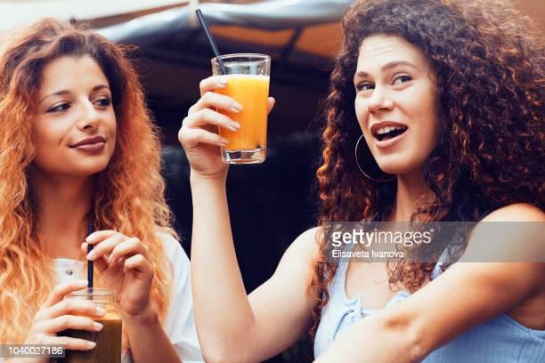 Girlfriends drinking juice