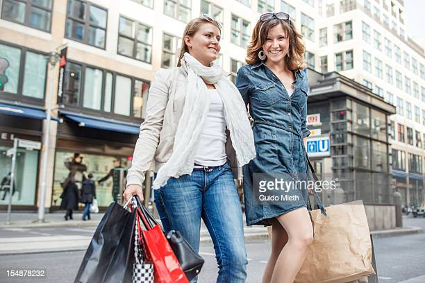 Girlfriends enjoy shopping in city.
