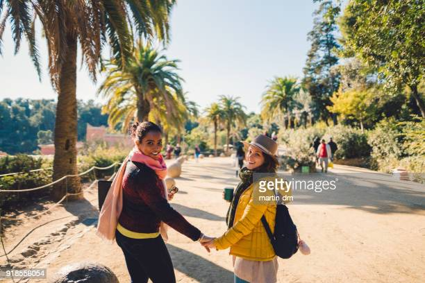 girlfriends enjoying a vacation in barcelona,park guell - catalonia stock pictures, royalty-free photos & images