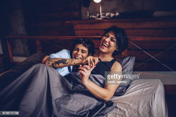 girlfriends fun in bed - lesbian date stock pictures, royalty-free photos & images