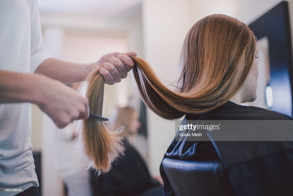 Cutting Hair Stock Photos And Pictures