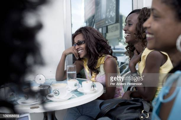 Girlfriends have coffee and chat at Kaldis a popular cafe on November 16 2010 in the Friendship shopping mall in Addis Ababa Ethiopia Some people can...