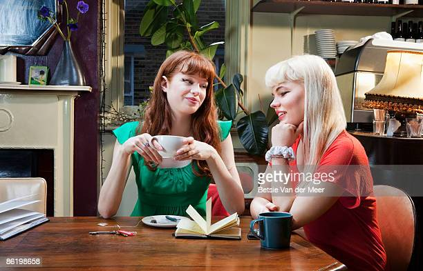 Girlfriends having a chat in cafe.