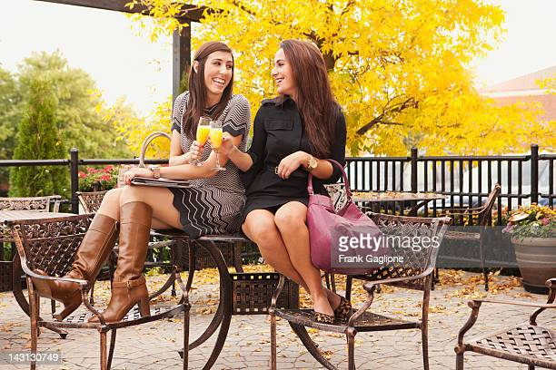 girlfriends having a mimosa. - metallic boot stock pictures, royalty-free photos & images